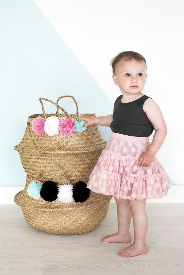 Olli Ella's fair-trade pom pom baskets are a sweet addition to a little girls room!