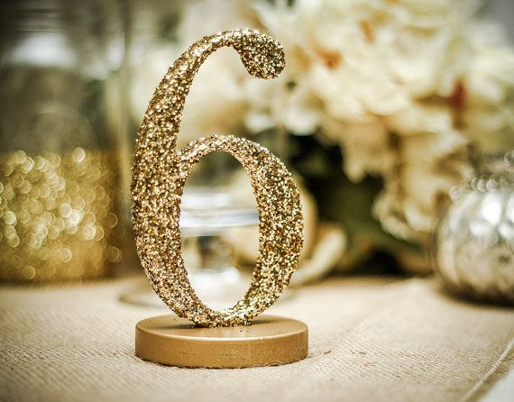 These hand glittered glitter wedding table numbers are carved in wood and painted in your choice of silver or gold metallic paint, then dipped in glitter - DIY?