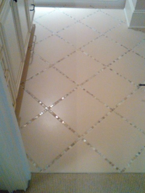 """Lay a thin strip of """"backsplash"""" tile in between the large tiles, instead of just using grout"""