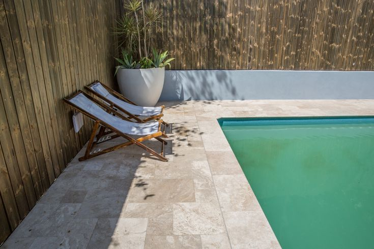Travertine pavers are low-maintenance and easy on the eyes, even on the brightest of Australian days.  #travertinepavers #landcapedesign #amazingbackyards #loveyourlifeoutdoors  #stonepavers #naturalpavers #thegreatoutdoors  #gardenarchitecture