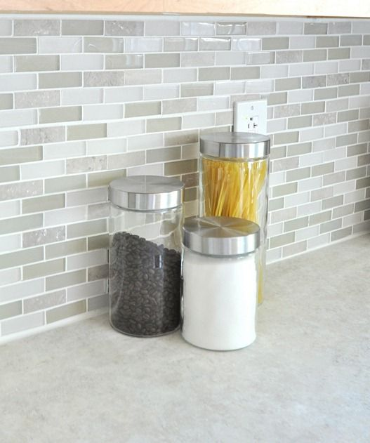 """glass tile backsplash -  medley of gray green glass, clear glass, and taupe ceramic 1"""" x 3"""" tile by Jeffrey Court called 'French Palace' right off the Home Depot shelf"""