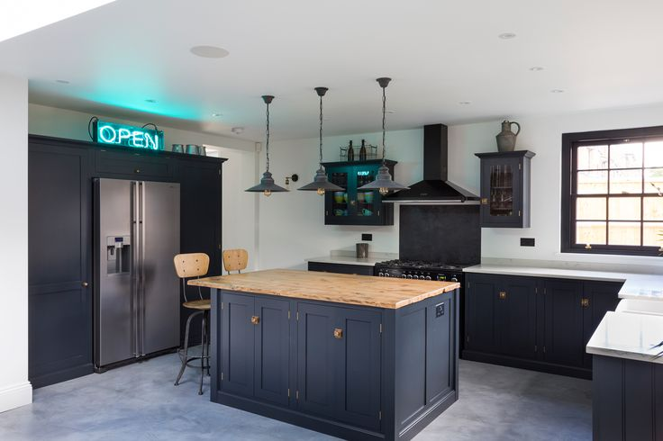 A super stylish deVOL Shaker kitchen in London painted in 'Pantry Blue' with brass door furniture. See more of this beautiful project on www.kempshottroad.co.uk. Photo credit: Nathan Pask