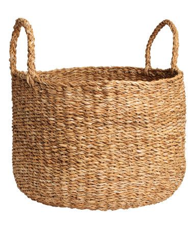 Natural. Large storage basket in thick, braided seagrass with two handles at top. Size 11 1/2 x 11 3/4 x 18 1/2 in.
