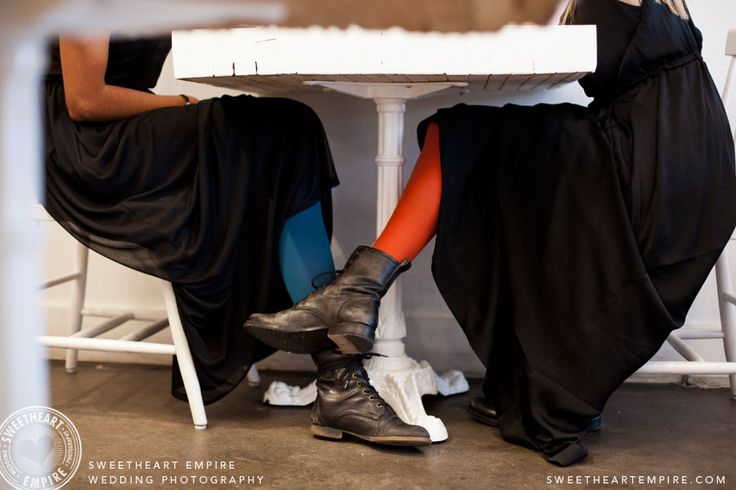 Playing footsie, in matching outfits! Brunch engagement photos at L'Ouvrier Kitchen Bar. Toronto Engagement photos, same-sex wedding, restaurant engagement session. #sweetheartempire #sweetheartempirephotography