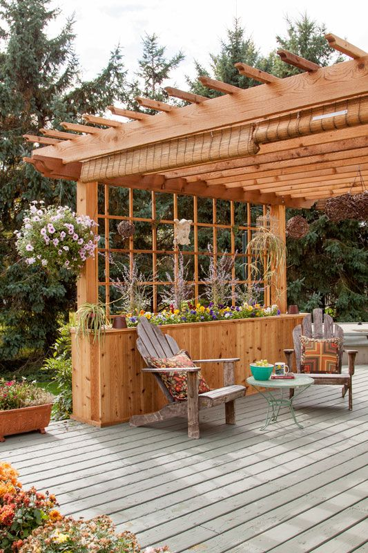 Finding a way to shield the sun while still enjoying the outdoors led to this gorgeous addition to a cabin deck space.