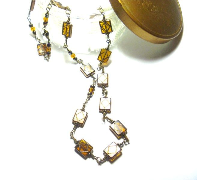 Antique Bronze Wire and Amber Color Glass Bead Jewelry Set   I made this necklace using pretty rectangle amber color flat glass beads and wire wrapped them with antique bronze wire. Necklace is embellished with antique bronze color beads, flower spacers, and amber color glass round beads. The necklace is finished with a lobster claw clasp. Measures 24 inches. Earrings measure 1 ¾ inches. Shipping is Free. $41.00