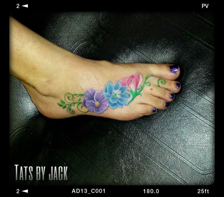 Birth Flower Foot Tattoo- Violet (February), Delphinium (July) and Sweet Pea (April). By Jack at Skin It Tattoos in Ogden, UT.