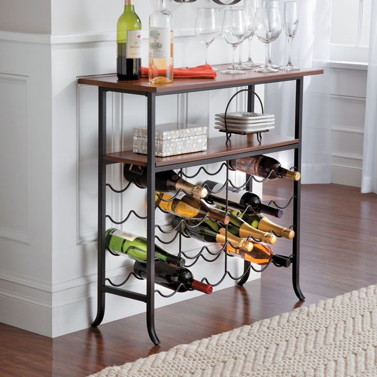 Multi-functional wine console holds 24 wine bottles and has 2 shelves to hold glasses and accessories. It's a unique small space wine storage solution