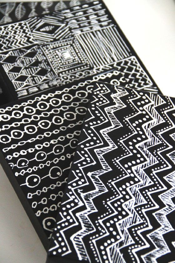 panels, with geometric patterns in white color on black background