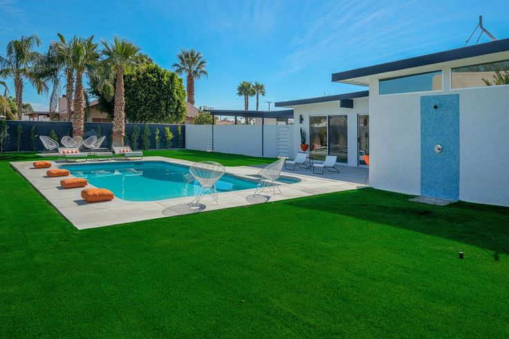 Modern Swimming Pool with Artificial turf grass, Pool with hot tub, Fence cushions and shower.