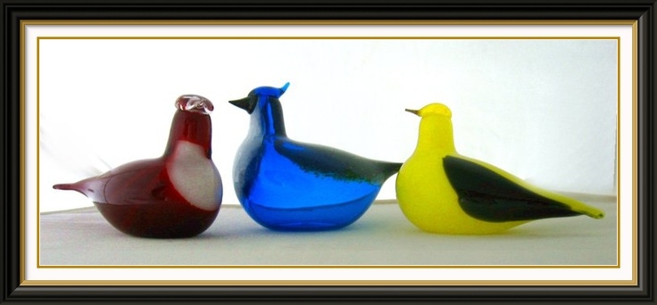 Primary color Toikka birds in landscape.