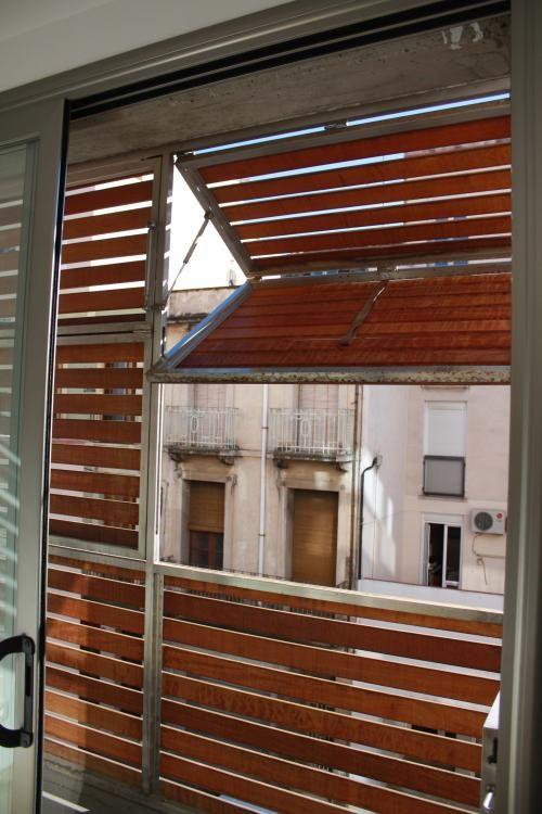 Wooden louvered shutter protecting balcony [213] | filt3rs via Pocket IFTTT Pocket balcony protection facade November 28 2015 at 07:31PM