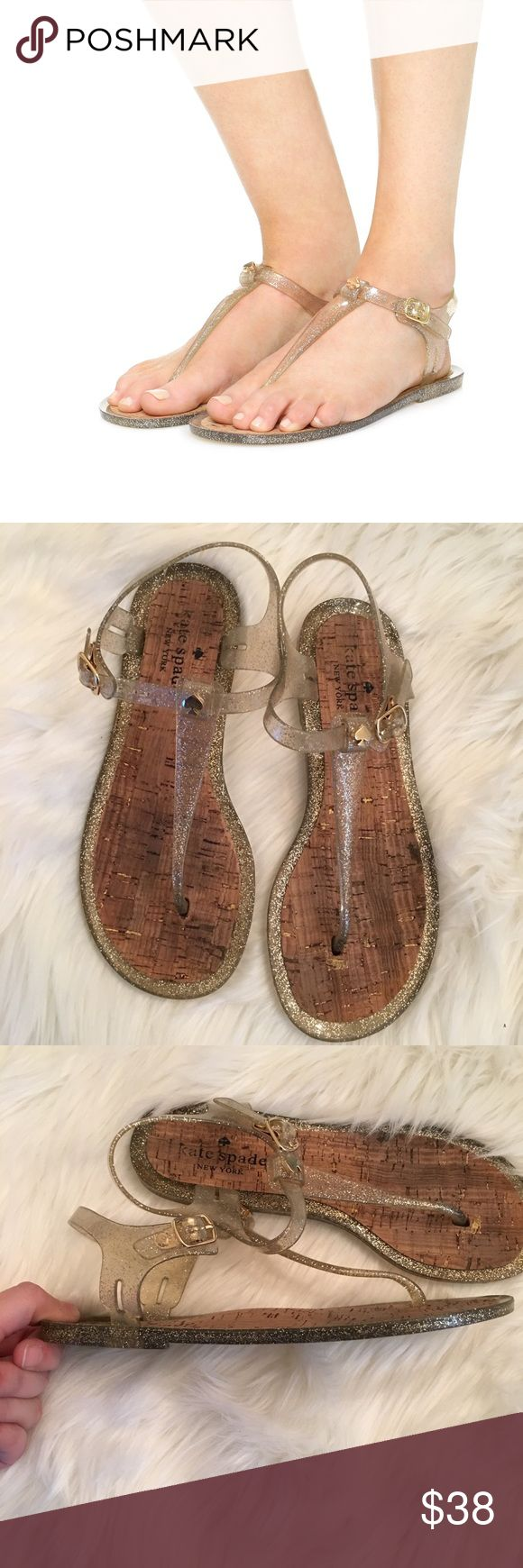 Kate Spade Yari Jelly Sandals Size 6 Super cute jelly KS jelly sandals. I'm good condition, but on the gold spades does have a few scuffs (shown in picture 5). Size 6 women's kate spade Shoes Sandals