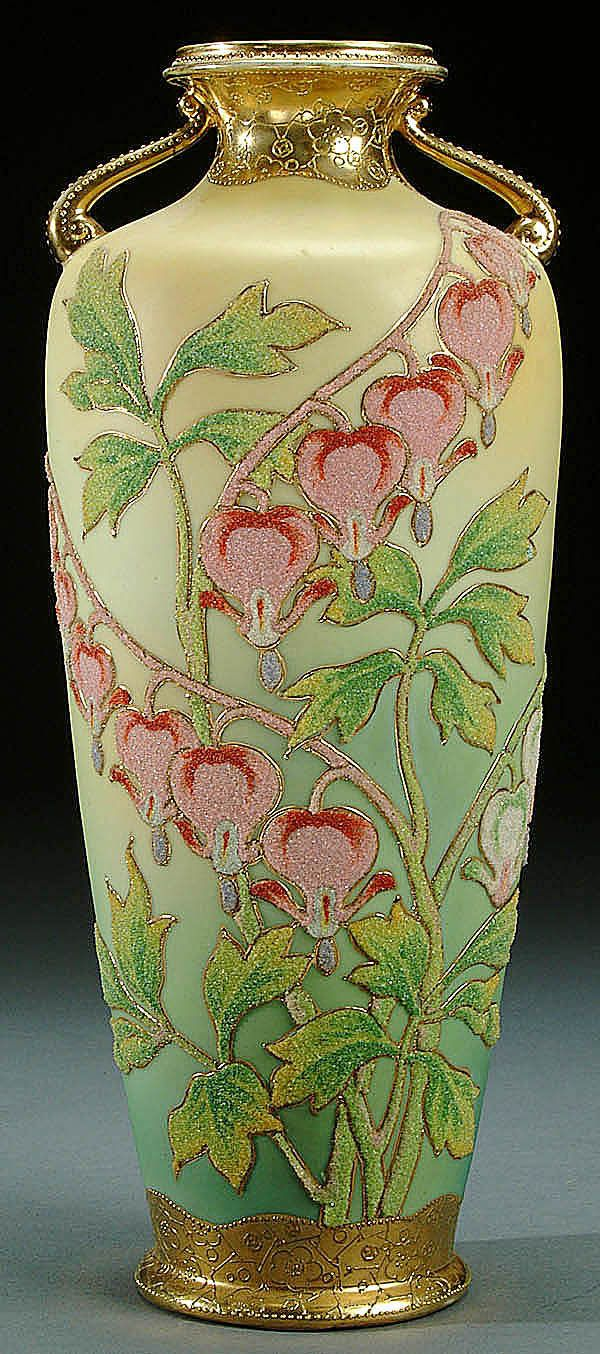 NIPPON CORALENE DECORATED PORCELAIN HANDLED VASE, CIRCA 1909 WITH BEADED GLASS DECORATION OF BLEEDING HEARTS ON A SHADED IVORY AND GREEN GROUND
