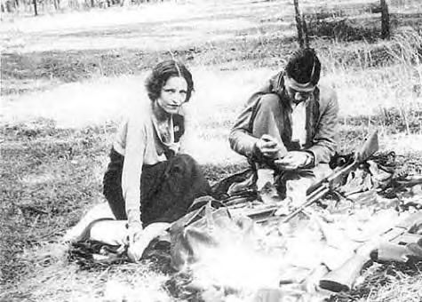 Bonnie & Clyde cleaning their guns.  Photo Album