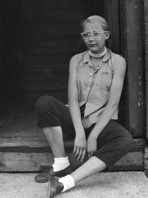 teen girl, minneapolis ca. 1953. Slouching, untucked, uncombed, but rocking the pearls!