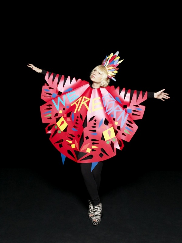 """Sia album cover: Paper poncho and """"feather"""" headdress by Benja Harney"""