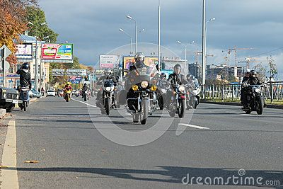 Column of motorcyclists makes running around town, which marks the end of the season. Primorskiy Prospect. Saint-Petersburg, Russia