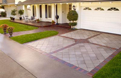 A driveway is the first thing you, your neighbors, and your visitors see from the street so it's an opportunity to make a lasting first impression. An attractive driveway can add value to your home much the same way a bathroom or kitchen makeover does.  This picture shows a driveway utilizing paving stones, which eliminates cracked surfaces that need repair, minimizing maintenance and overall cost.