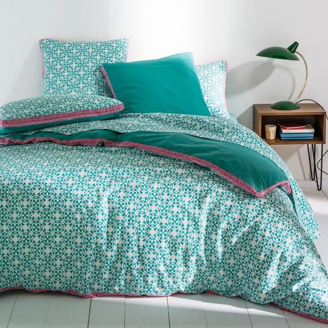 Yucatan 100% cotton duvet cover. Gypsy style for the Yucatan duvet cover with a play on stylised mini motifs and matching colours.Yucatan duvet cover:  Duvet cover: blue and white micro motifs on the front, plain turquoise blue print on the back.Multicoloured ribbon edging.100% cotton, 57 threads/cm²: The higher the thread count, the higher the quality of the weave.Straight hem.  Easy care.  Machine washable at 60°C.    See the full Yucatan bed linen collection online.      The Oeko-Tex®...