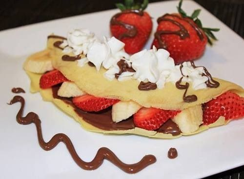 yum make a crepe fill it with home made frosting or nutellla, then add strawberrys great breakfest