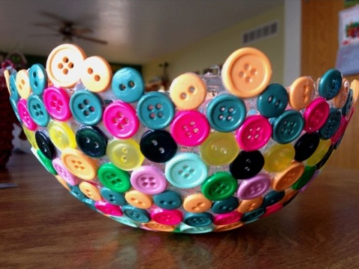 Blow up balloon, glue buttons to it, pop balloon, then a nice colorful bowl!!