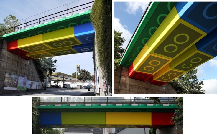 Street artist Megx converted a bridge in Wuppertal, Germany into a giant Lego structure using colored panels that create the illusion of being the underside of Lego bricks