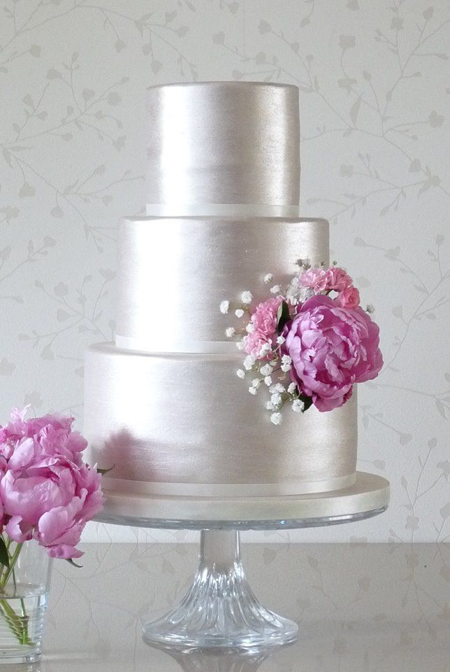 Silver wedding cake with peony accent.  Indian Weddings Inspirations. Silver Wedding Cake. Repinned by #indianweddingsmag indianweddingsmag.com #weddingcake
