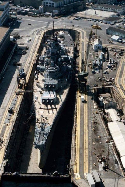 An aerial view of battleship USS Iowa (BB-61) in Dry Dock No. 4 at Norfolk Naval Shipyard 1 May 1985.