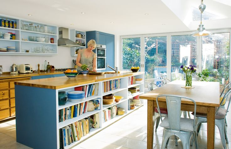 Jane Wymark and husband Paul Howson transformed a small galley kitchen into the large, sociable space they had always wanted, with a beautiful extention, adding wall-to-wall glass doors and a rooflight to increase natural light and some innovative storage solutions to maximise space