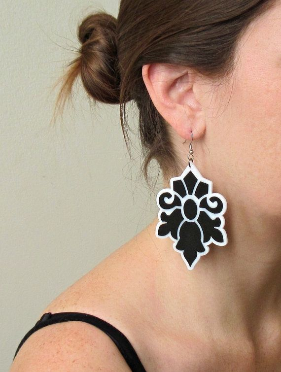 """Black and White Lotus Earrings - Bridesmaid Jewelry - Romantic Jewelry - Cocktail Jewelry - Party Jewelry - Evening Jewelry  These unique & romantic floral design earrings are made from a combination of black and white acrylic parts, they hang on NICKEL FREE gold plated over brass earwires.  These earrings make a bold statement, yet are surprisingly lightweight and easy to wear.  Length: 3.54"""" (9cm) Width: 2.1"""" (5.5cm)  All of my jewelry comes with a gift box.  $65"""
