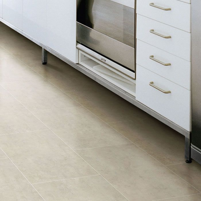Inspired by the allure of natural stone and the sheen of metallics, this rectangular tile combines the two aesthetics to create an elegant and unique effect. whether installed alone, with accompanying Grouting Strip or even contrasting wood, the delicate tones of Polyflor Camaro White Metalstone 2332 Vinyl Flooring allows you creative freedom. The floor displayed is laid in brickwork fashion with Ice Grouting Strip.