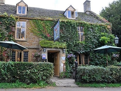 The 16th century pub The Falkland Arms in Great Tew, Oxfordshire, England
