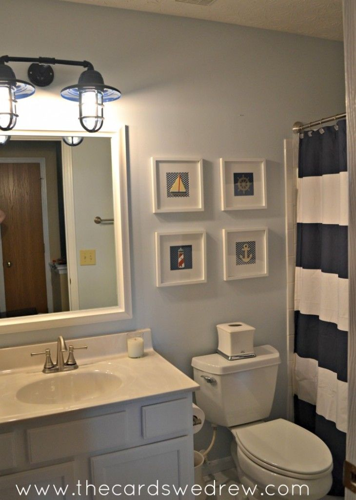Tons of easy updates for a Nautical Bathroom makeover in navy blue and green with touches from Moen, Barn Light Electric, MirrorMate, Evie Ivy, Ryobi tools, and more!