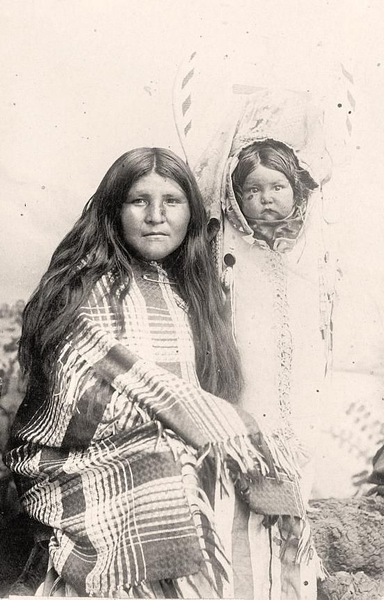 White River Ute mother. It was taken in 1916 by Harris & Ewing.