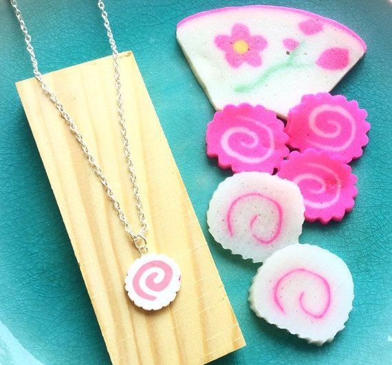 This is a Narutomaki necklace. 100% handmade   What is Narutomaki? Answer: It is a common topping on Japanese noodles such as Tokyo-style ramen. It is also a cute fashion symbol in Japan. Material: polymer clay. Narutomaki size: around 0.7 inch big Necklace chain is 19 inches long The listing price is for one necklace.  I also have Naruto rings and earrings in my Etsy store. Please feel welcome to take a look. Thank you  Narutomaki rings https://www.etsy.com/list