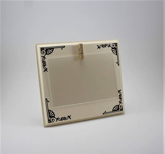 cream picture frame brown picture frame small picture frame clip picture frame 4 x 6 picture frame custom picture frame This is a fun pictures frame to show off your pictures. This picture frame is 6 3/4 by 7 3/4 by 1/2 thick. The sides have been routered to give it a unique look. It holds a 4 x 6 picture. The frame shown here is # 5 Cream with Toffee Brown designs in the corners. It is available in different colors, please choose one when ordering. Picture is held in place wi...
