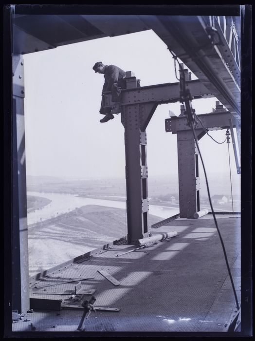 Man Sitting On Steel Beam Of Boat Lift Under Construction