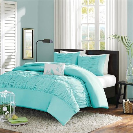 The Mirimar Duvet Cover Set creates an opulent look for your bedroom to update your current décor. The ruched fabric on the comforter and shams give the appearance of scalloped edges and ruffles covering the bed. One solid white decorative pillow completes this set with an embroidered leaf and bird motif. Made from polyester peach skin fabric, the bright blue comforter and sham have a soft feel and are machine washable for easy care.