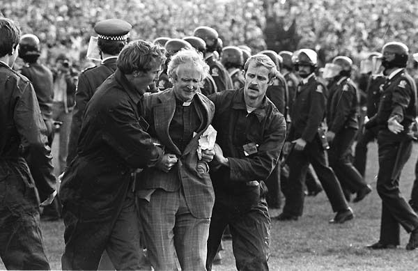 Rev George Armstrong is someone I've had the pleasure of interviewing about his life and his peace activism. Here is being taken away from a peaceful demonstration during the anti-Springbok tour of NZ protests of 1981. https://globalenglishnz.files.wordpress.com/2012/05/2845257.jpg