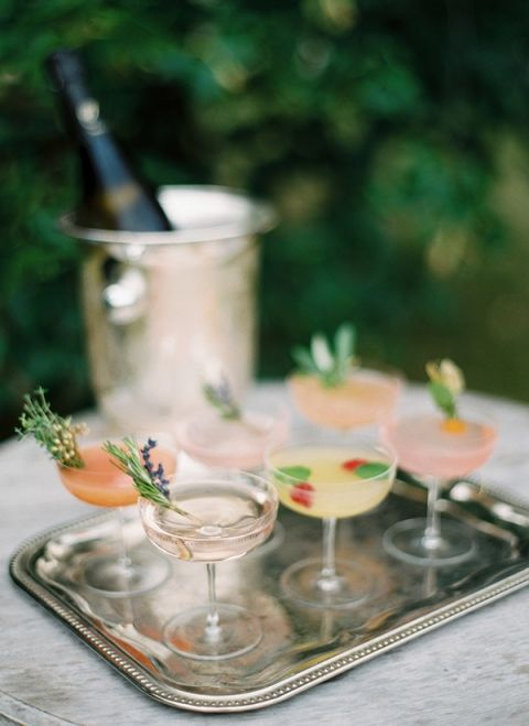 Cheerful Cocktails Garnished with Edible Flowers | Peaches & Mint Photography | A Blooming Spring Wedding full of Lush Flowers in Peach and Fresh Green - http://heyweddinglady.com/blooming-spring-wedding-full-of-lush-flowers/