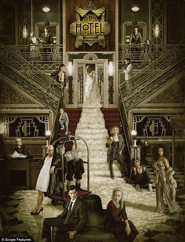 Taking centre-stage: Gaga stands on the staircase with her long hair spilling down to the floor with Angela on the far right as they pose with the cast for American Horror Story: Hotel, which returns to FX on October 7
