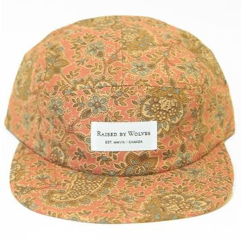 Raised By Wolves Algonquin 5 Panel Cap - Blush Civil War Paisley  Label: Raised By Wolves   Format: Cap  £25.00 (£30.00 inc VAT)     Canadian born brand Raised By Wolves takes its inspiration from Skate culture, Urban clothing, and other popular trends combining them to create unique and one of a kind pieces of clothing.   •	Blush Civil War Paisley colourway  •	Cotton body  •	Raised By Wolves woven label detail  •	Web fabric adjuster at the back  •	Made in USA