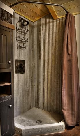 cast concrete shower pan and galvanized walls make a great bathroom combo for a rustic modern farmhouse design for mud room half shower wash area - Modern Rustic Shower