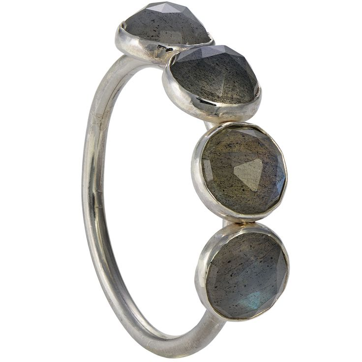 The rose cut labradorite stones in this sterling ring are so mysterious that their shine cannot be caught in a photo. They seem to emit an inner blue light, floating in a gray mist. The size of the ring is satisfying and all four of this beautiful stones, in a substantial size, will adorn your hand gracefully.