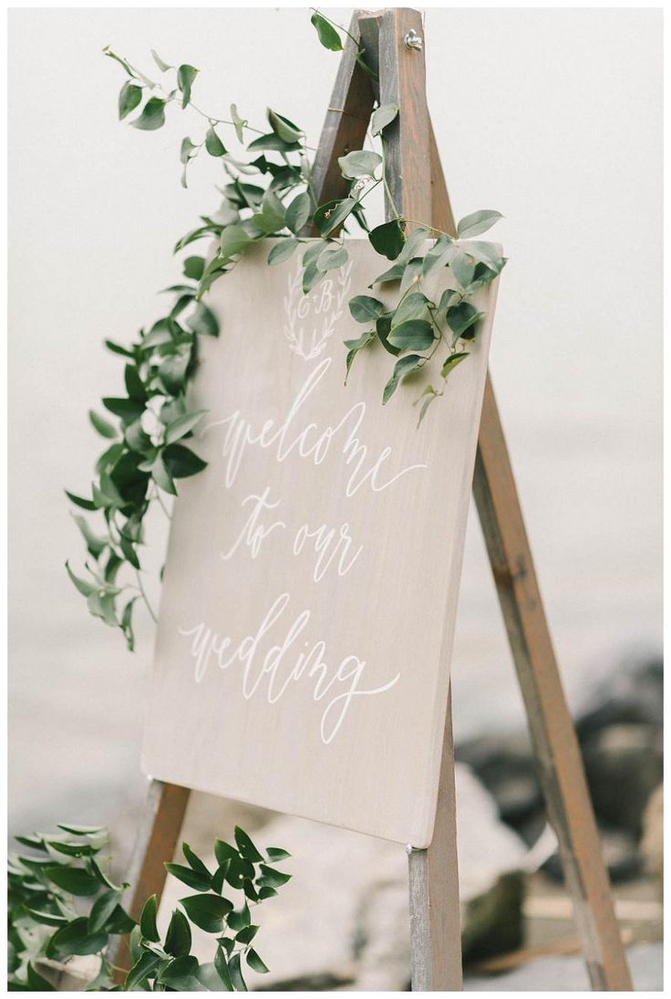 Wedding sign with white calligraphy by Laura Hooper Calligraphy. Image by Elizabeth Fogarty.
