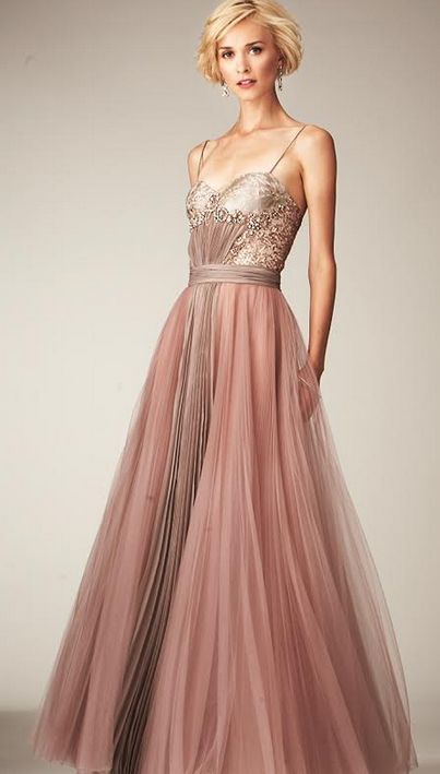 Click through to link to see non-white wedding dresses for the non-conventional bride