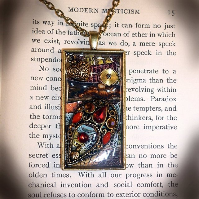 """Treasured - A large, sumptuous, resin pendant with a digital collage background (Clockwork Jewel's copyright), vintage jewellery and watch parts, glass, brass, bits and bobs of gorgeousness. On a chain length of your choice 16""""-18""""-20""""-22""""  Size - 5cm x 2.7cm  Price - £22.99"""