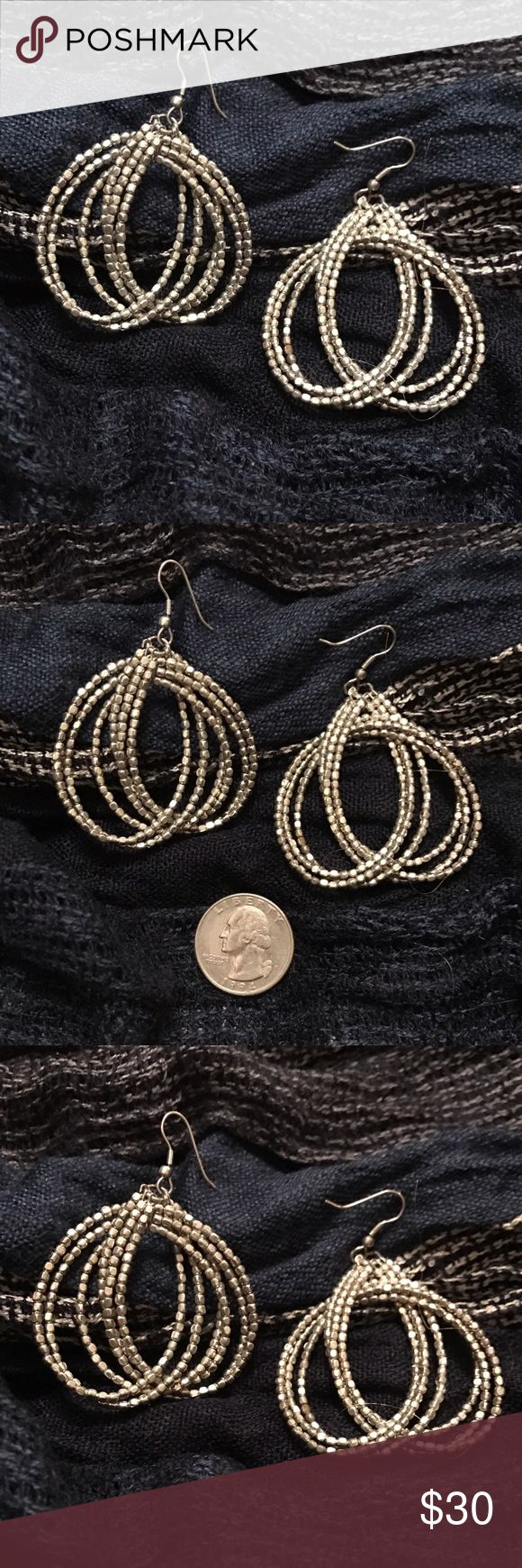 Anthropologie Earrings Brushed silver, tiny beaded wire dangle earrings. Great to throw on with your pretty summer dresses! A little over an inch in length. So pretty! No trades, thank you. Anthropologie Jewelry Earrings