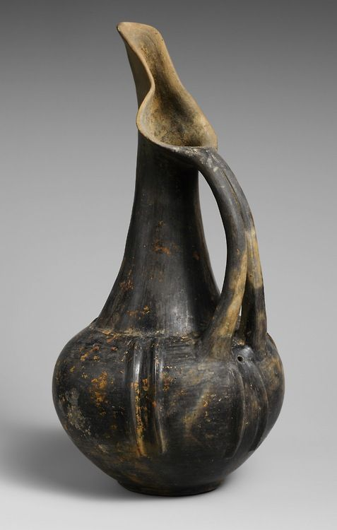 Terracotta beak-spouted jug, ca. 750–690B.C. 'This particular type, with split handle and modeled ribs, was especially popular in Bisenzio, during the transition between Villanovan and Early Etruscan culture.'(via The Metropolitan Museum of Art)